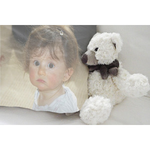 Picture Of Your Child On The Pillow Next To A Doll photo effect
