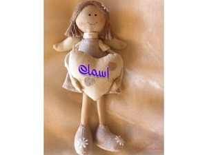 Type your lover's name on the doll and the heart